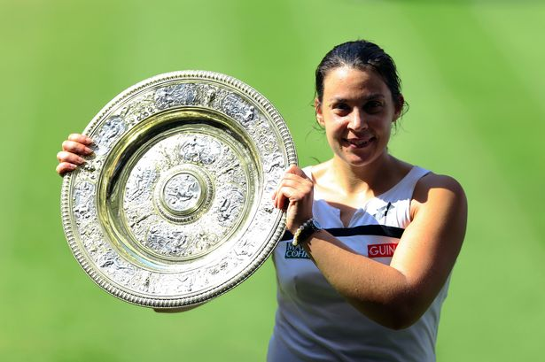 Frances-Marion-Bartoli-poses-with-the-trophy